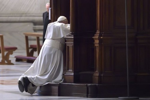 Pope Francis goes to confession during Lenten penance service in St. Peter's Basilica